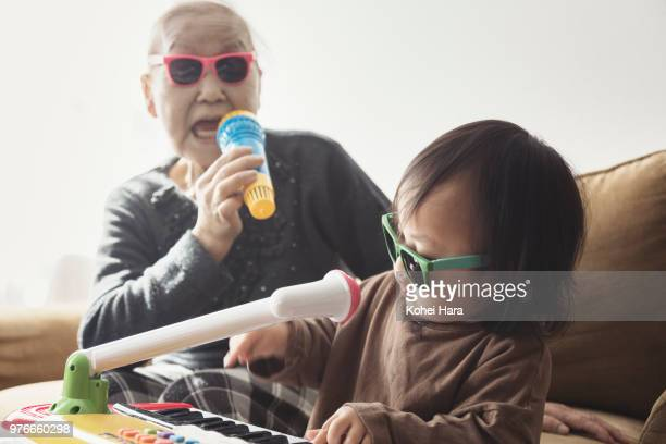 homemade rock band wearing toy sunglasses - disruptagingcollection stock photos and pictures