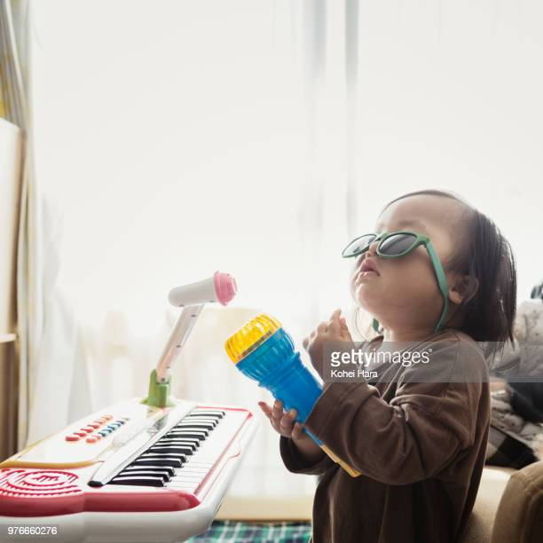 homemade rock singer wearing toy sunglasses - keyboard player stock pictures, royalty-free photos & images