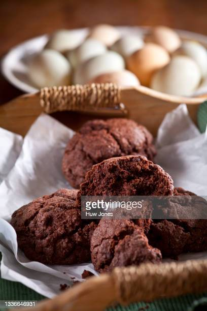 homemade rustic chocolate cookies stacked up in a wooden tray, in a home style setting - close up stock pictures, royalty-free photos & images
