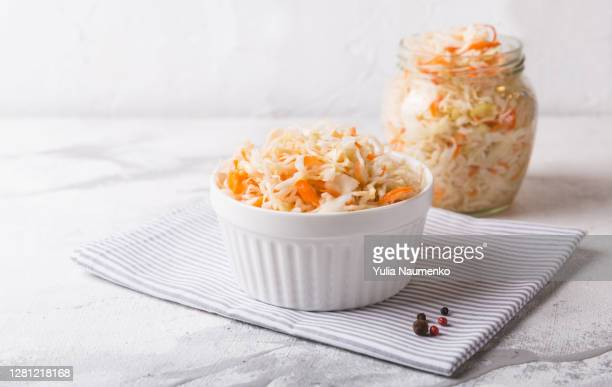 homemade sauerkraut in a plate. fermented cabbage in a bowl. - 副菜 ストックフォトと画像
