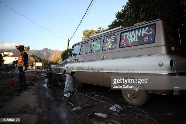 A homemade sign is painted on the side of a van after a mudslide on January 10 2018 in Montecito California 17 people have died and hundreds hundreds...