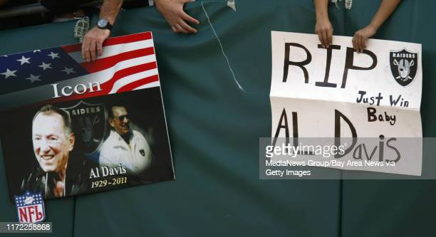 Homemade signs seen during a pregame tribute to recently passed away Oakland Raiders owner Al Davis Sunday Oct 16 2011 at Oco Coliseum in Oakland...