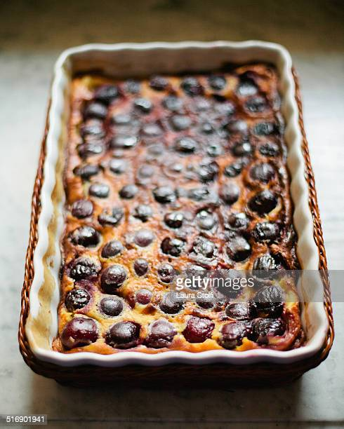 Homemade sour cherry clafoutis in china baking pan