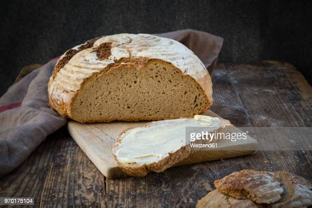 homemade sourgough rye bread on chopping board - loaf of bread stock pictures, royalty-free photos & images