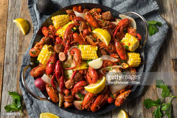 homemade southern crawfish boil - boiled stock pictures, royalty-free photos & images