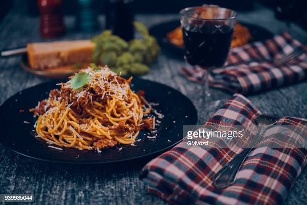 homemade spaghetti bolognese served on a plate - bolognese sauce stock pictures, royalty-free photos & images