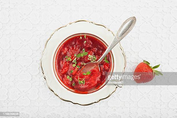 homemade strawberry jam with herbs - doily ストックフォトと画像