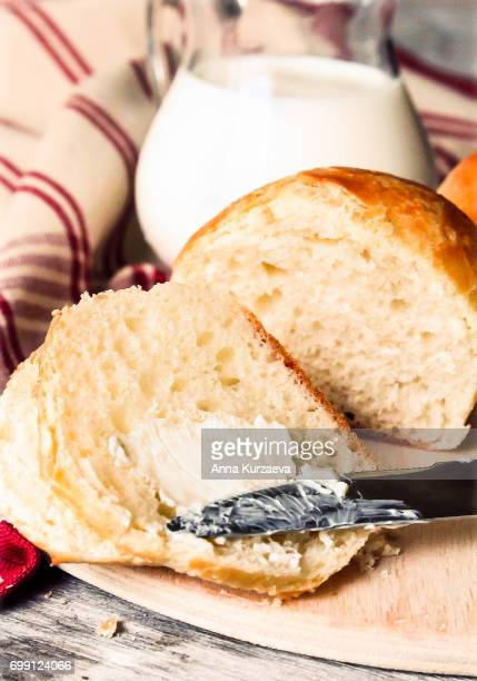 homemade sweet buns called brioche with a pot of fresh milk, selective focus - sweet bun stock pictures, royalty-free photos & images