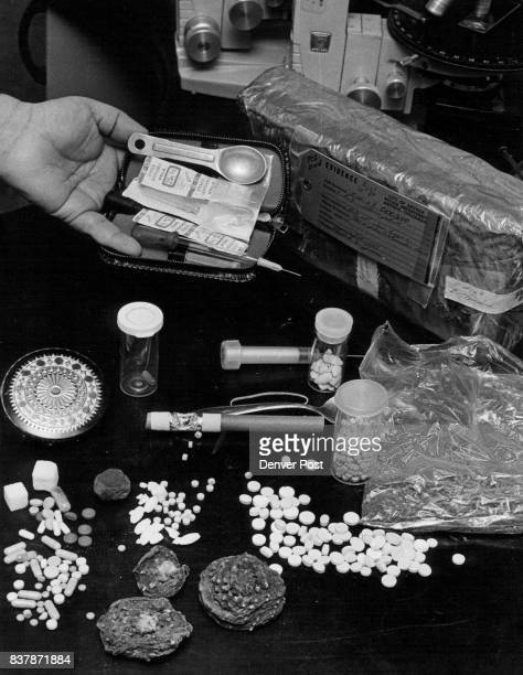 Homemade syringe kit was brought to the lab Displayed on the table are peyote buds LSD STP tablets and other drugs brought to the laboratory for...