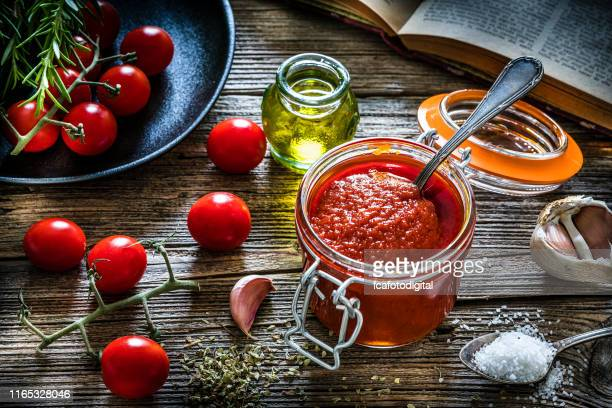 homemade tomato sauce in a glass jar - tomato sauce stock pictures, royalty-free photos & images