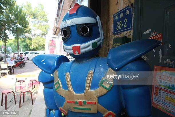 A homemade transformer stands as a security at a door of residential building at the intersection of Kaiyuan Street and Wanbao Street on July 5 2015...