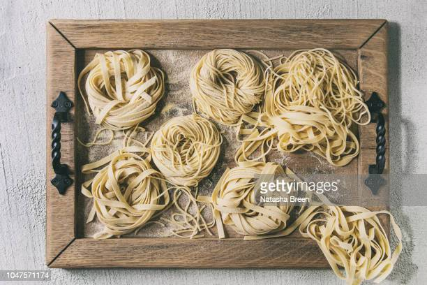 homemade uncooked pasta - pasta stock pictures, royalty-free photos & images
