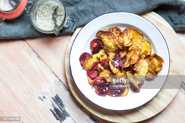 Homemade vegetable chips made of beetroots and turnips with sea salt