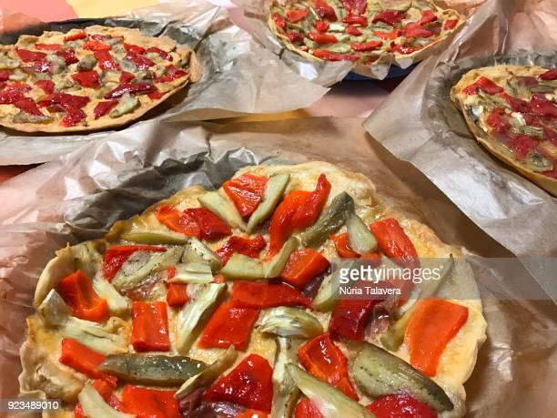 homemade vegetable pizzas on a table - vegetarian pizza stock pictures, royalty-free photos & images