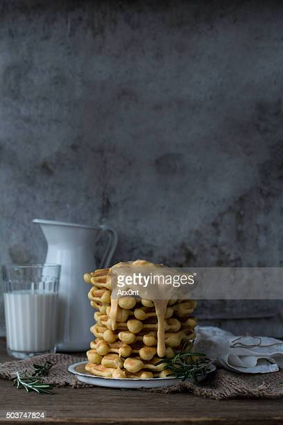 homemade waffles with sauce - cheese sauce stock photos and pictures