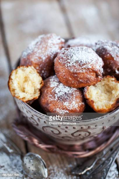 homemade warm apple fritters in bowl - fritter stock photos and pictures