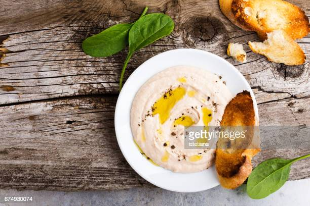 homemade white bean dip on rustic wooden table - spread food stock pictures, royalty-free photos & images