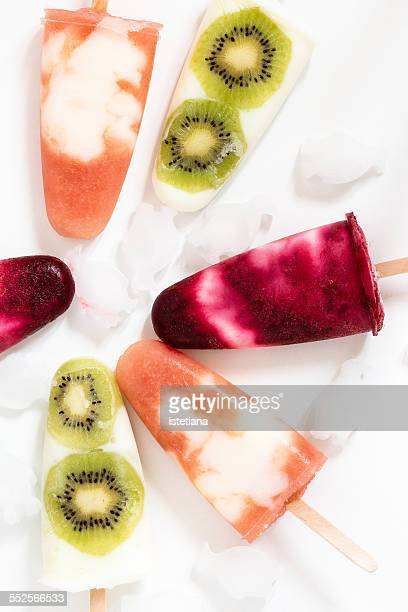 Homemade yogurt ice pops with fresh fruit juice