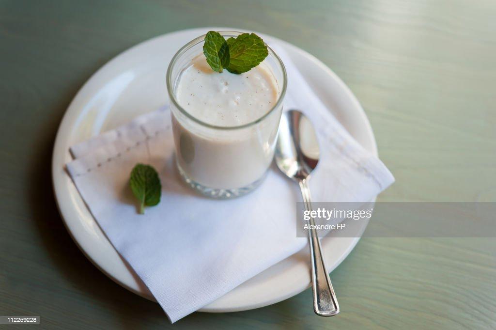 Homemade yogurt with fresh mint leaves : Stock Photo