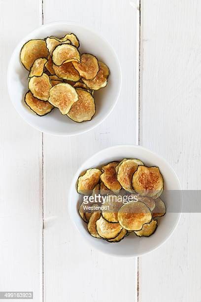 homemade zucchini chips in bowls - zucchini stock pictures, royalty-free photos & images