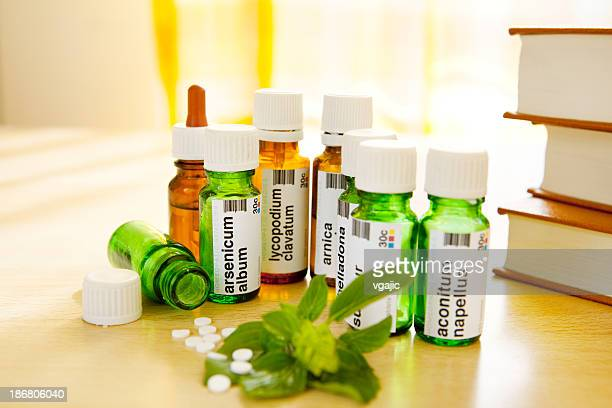 homeopathic medicine: remedies and books - homeopathic medicine stock photos and pictures