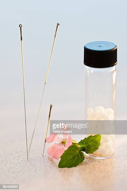 homeopathic remedy - acupuncture needle stock pictures, royalty-free photos & images