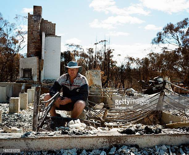homeowner in ruins of burnt out house - ember stock pictures, royalty-free photos & images