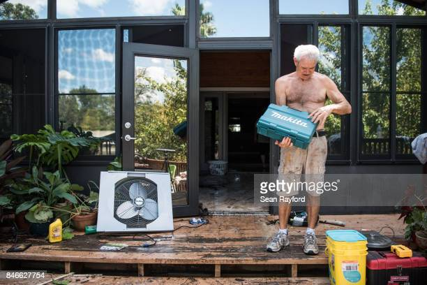 Homeowner James Wade checks for water damaged items as floodwaters from Hurricane Irma recede September 13 2017 in Middleburg Florida Flooding in...