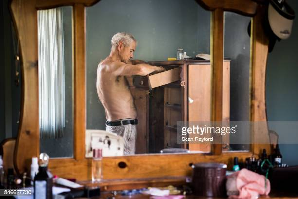 Homeowner James Wade cleans out a dresser as floodwaters from Hurricane Irma recede September 13 2017 in Middleburg Florida Flooding in town from the...