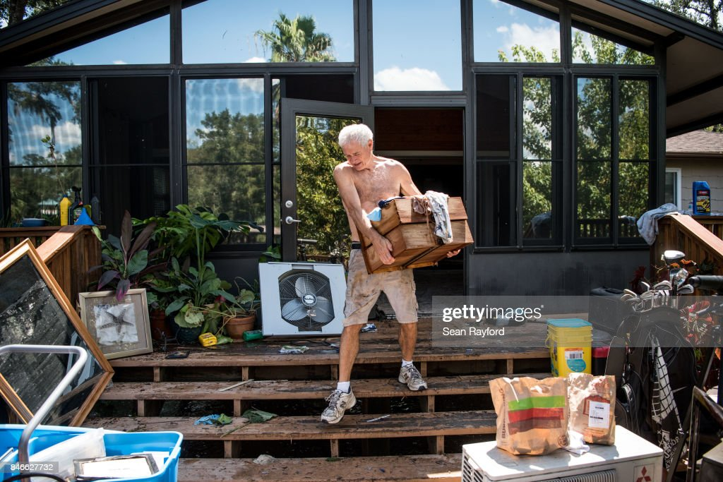 Homeowner James Wade removes damaged items as floodwaters from Hurricane Irma recede September 13, 2017 in Middleburg, Florida. Flooding in town from the Black Creek topped the previous high water mark by about seven feet and water entered the second story of Wade's home.