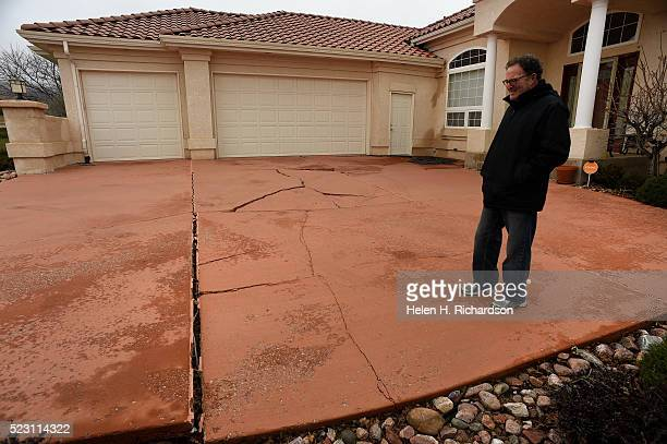 Homeowner Jim Millman stands in his cracked driveway at his home in the Broadmoor Bluffs on April 11 2016 in Colorado Springs Colorado He and some of...