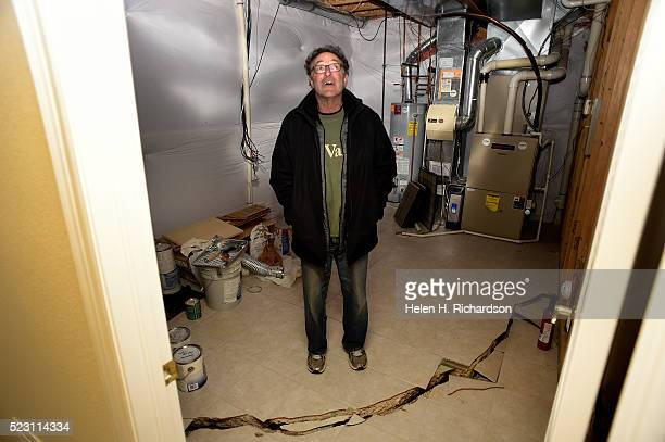 Homeowner Jim Millman stands in the cracked basement at his home in the Broadmoor Bluffs on April 11 2016 in Colorado Springs Colorado He and some of...
