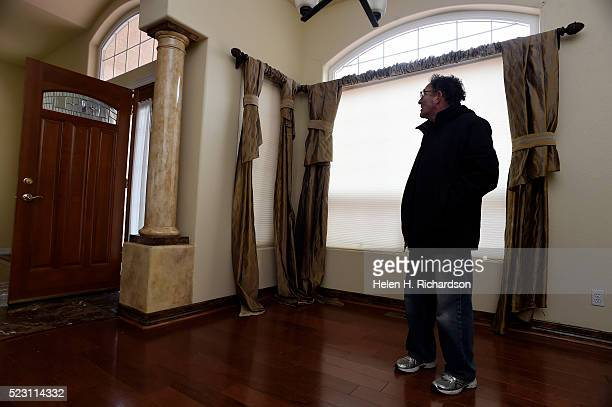 Homeowner Jim Millman stands in the living room of his home in the Broadmoor Bluffs on April 11 2016 in Colorado Springs Colorado The curtains all...