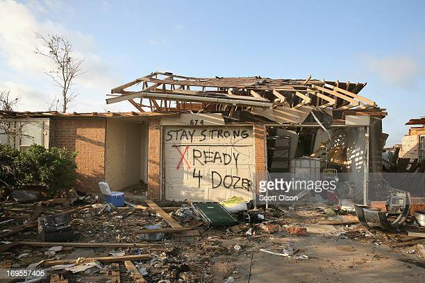 A homeowner lets workers that his home has been cleared of valuables after it was destroyed by the May 20 tornado on May 27 2013 in Moore Oklahoma...