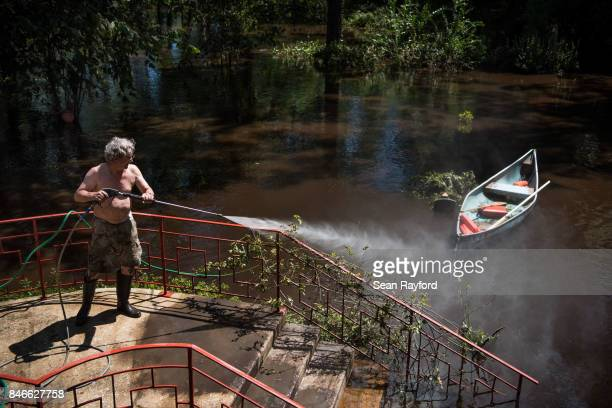 Homeowner Mike Riley power washes his front steps as floodwaters from Hurricane Irma recede September 13 2017 in Middleburg Florida Flooding in town...