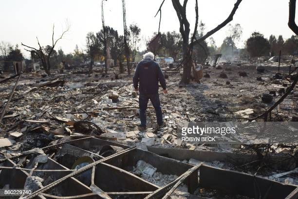 TOPSHOT Homeowner Phil Rush looks at the remains of his home destroyed by wildfire in Santa Rosa California on October 11 2017 Rush said he and his...
