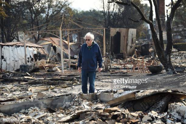 Homeowner Phil Rush looks at the remains of his home destroyed by wildfire in Santa Rosa California on October 11 2017 Rush said he and his wife and...