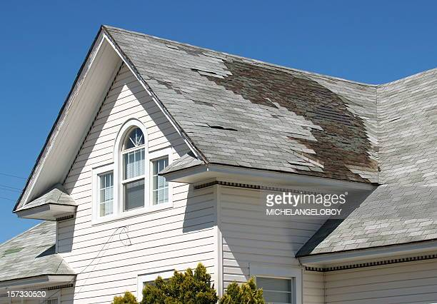 homeowner roof repair - roof stock photos and pictures
