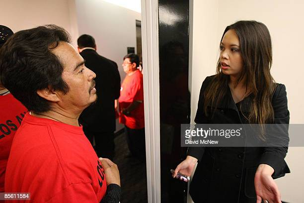 Homeowner William Cabrera and a woman who identifies herself only as the property manager talk as ACORN activists visit the new offices of the...