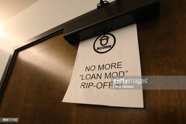 Homeowners and ACORN activists leave a message reading 'No more 'loan mod' ripoffs' on the door of the new offices of the forprofit loan modification...