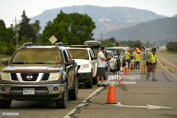 Homeowners give a thumbs up as they wait in line to be allowed back into their homes on June 13 2018 in Hermosa Colorado A select group of...