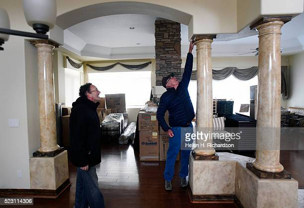 Homeowners Jim Millman left and his neighbor Denny Cripps middle check out the damage to Millman's home in the Broadmoor Bluffs on April 11 2016 in...