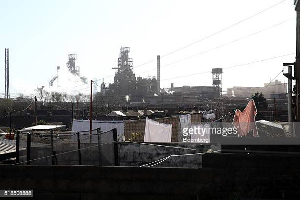 Homeowners washing hangs on a line in their back garden against a backdrop of the steel works operated by Tata Steel Ltd. In Port Talbot, U.K. On...