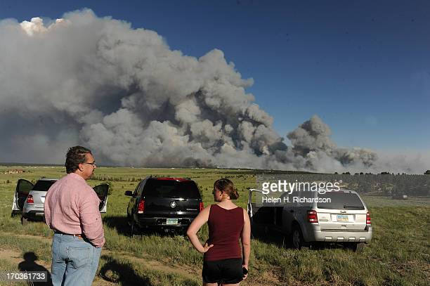 Homeowners watch the fire from a high meadow north of the fire A wild land fire started around 200 in the Black Forest northeast of Colorado Springs...