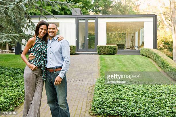 homeowners with glass house - heterosexual couple stock pictures, royalty-free photos & images