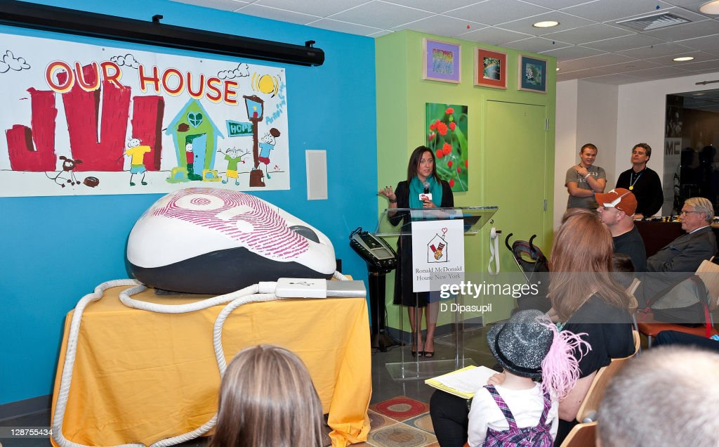 Homepage Sales Executive Director Christa Zambardino (C) speaks at the unveiling of the AOL media room at the Ronald McDonald House on October 7, 2011 in New York City.