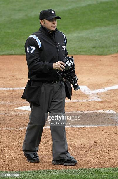 Homeplate umpire Mark Wegner oversees the action as the New York Mets face the Colorado Rockies at Coors Field on May 12 2011 in Denver Colorado