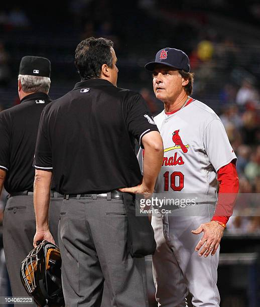 Homeplate umpire Mike DiMuro and manager Tony LaRussa of the St Louis Cardinals against the Atlanta Braves at Turner Field on September 9 2010 in...