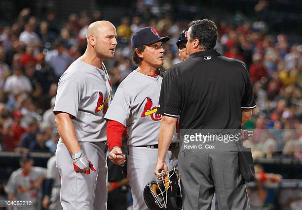 Homeplate umpire Mike DiMuro manager Tony LaRussa and Matt Holliday of the St Louis Cardinals against the Atlanta Braves at Turner Field on September...