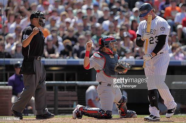 Homeplate umpire Vic Carapazza calls the third strike as Jason Giambi of the Colorado Rockies strikes out swinging with the bases loaded for the...